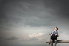 Businessman on bench Royalty Free Stock Photos