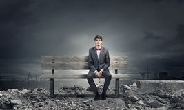 Businessman on bench Royalty Free Stock Image