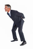 Businessman bending with arms on his back Stock Images
