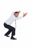 Businessman bending with arms up. On white background Stock Photography
