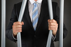 Businessman Bending Bars Of Jail. Close-up Of Businessman Hand Bending Bars Of Jail Royalty Free Stock Photo