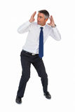 Businessman bending and with head between hands Royalty Free Stock Images