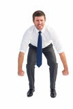 Businessman bending and lifting Royalty Free Stock Photos
