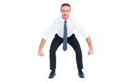 Businessman bending and lifting Royalty Free Stock Photo
