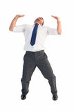 Businessman bending and pushing Royalty Free Stock Images