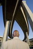 Businessman beneath overpasses, rear view Royalty Free Stock Photography