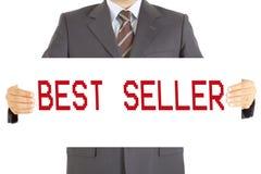 Businessman best seller board on hends. Best seller board on the hand of businessman Royalty Free Stock Photo