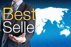 Businessman with Best seller word on world map background.  Stock Photography