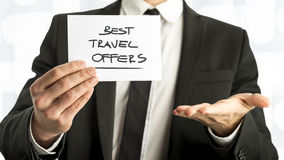Businessman with Best Travel Offers Texts on Paper Royalty Free Stock Photography