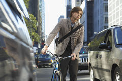 Businessman With Bicycle On Busy Street Royalty Free Stock Image