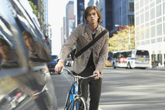 Businessman With Bicycle On Busy Street Royalty Free Stock Photography