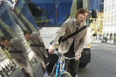 Businessman With Bicycle On Busy Street Royalty Free Stock Photo