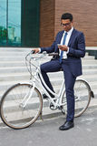 Businessman on bicycle Royalty Free Stock Photography
