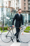 Businessman with bicycle. Royalty Free Stock Image