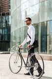 Businessman with bicycle. Royalty Free Stock Photos