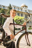 Businessman with bicycle Royalty Free Stock Photos