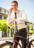 Businessman with bicycle Royalty Free Stock Photography