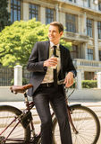 Businessman with bicycle Stock Photos