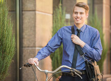 Businessman with bicycle Royalty Free Stock Image