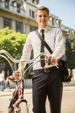 Businessman with bicycle Stock Photo
