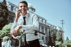 Businessman with bicycle. Businessman riding a bicycle to workplace for protecting environment stock images