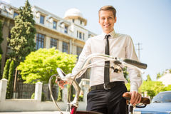 Businessman with bicycle Stock Image