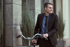 Businessman with bicycle. Businessman in suit going to work on his bicycle. Healthy lifestyle concept royalty free stock photos
