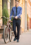 Businessman with bicycle Royalty Free Stock Photo