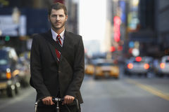 Businessman With Bicycle On Urban Street Stock Image