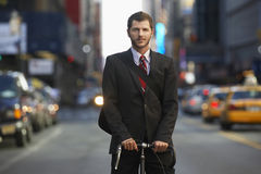 Businessman With Bicycle On Urban Street Royalty Free Stock Photography
