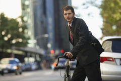 Businessman With Bicycle On Urban Street Royalty Free Stock Images