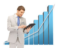 Businessman with big 3d chart Royalty Free Stock Photos