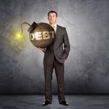 Businessman with big debt bomb Royalty Free Stock Photo