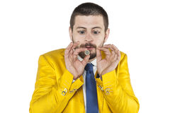 Businessman with big eyes looking at his coin Royalty Free Stock Image