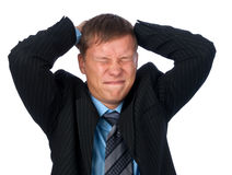 Businessman with a big headache Stock Photography