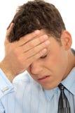 Businessman with a big headache Stock Photos
