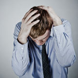 Businessman with a big headache Stock Image