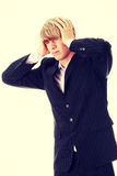 Businessman with a big headache Stock Images