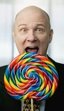 Businessman with Big Lollipop Stock Photography