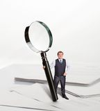 Businessman with big loupe Royalty Free Stock Image