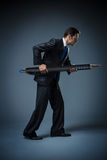 Businessman with a big pen Royalty Free Stock Photography