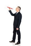 Businessman with big red pencil Stock Images
