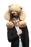 Businessman with big soft toy on shoulders Stock Photo