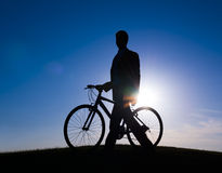 Businessman and a Bike on the Hill Royalty Free Stock Photo