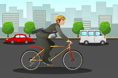 Businessman biking in the city Royalty Free Stock Image