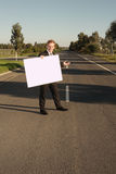 Businessman billboard invites Stock Photography