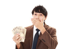 Businessman with bills Royalty Free Stock Images