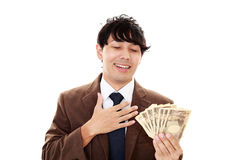 Businessman with bills Royalty Free Stock Photo
