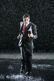 Businessman With Binder Running In Rain Stock Image