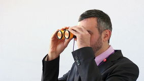 Businessman with binocular foresee the future Stock Images